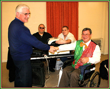 Tony Kennard formally presenting the video projector to Dominic Cox for the Thurrock Lions.